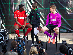 LIVERPOOL, ENGLAND - Thursday, April 10, 2014: Liverpool players Kolo Toure and goalkeeper Simon Mignolet at the launch of the new Warrior home kit for 2014/2015 at the Liverpool One shopping centre. (Pic by David Rawcliffe/Propaganda)