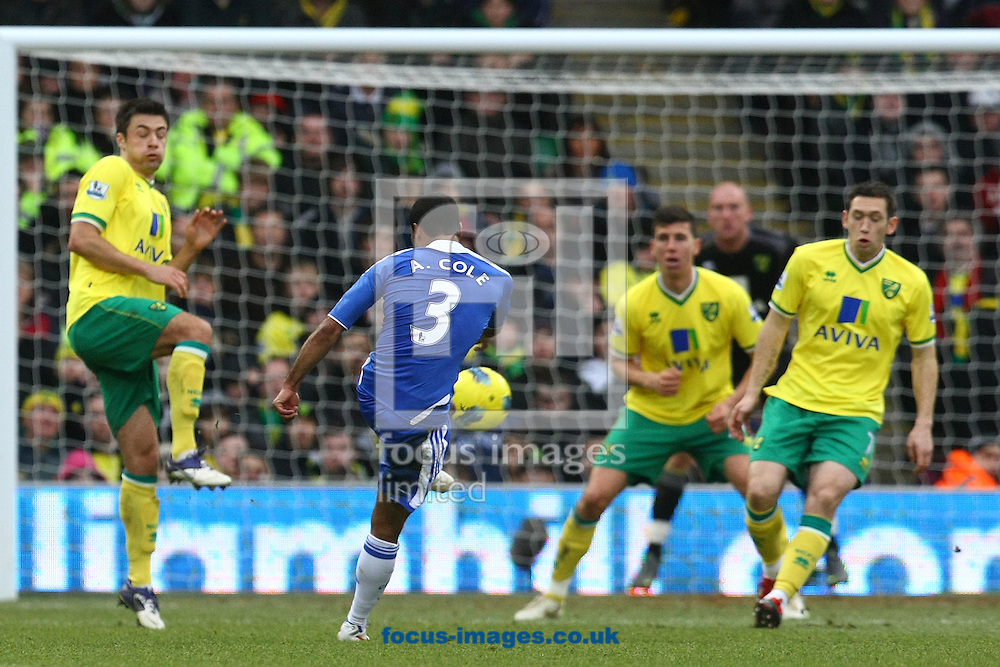Picture by Paul Chesterton/Focus Images Ltd.  07904 640267.21/01/12.Chelsea's Ashley Cole has a shot on goal during the Barclays Premier League match at Carrow Road Stadium, Norwich.