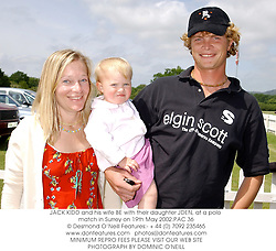 JACK KIDD and his wife BE with their daughter JDEN, at a polo match in Surrey on 19th May 2002.PAC 36