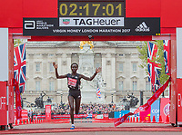 Mary Keitany KENraises her arms as she crosses the finish line winning the elite women's race. The Virgin Money London Marathon, 23rd April 2017.<br /> <br /> Photo: Roger Allen for Virgin Money London Marathon<br /> <br /> For further information: media@londonmarathonevents.co.uk