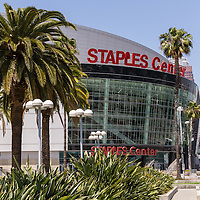 Picture of the Staples Center in downtown Los Angeles, California. The Staples Center is an arena that hosts sports, concerts and other entertainment events. Staples Center is home to the NBA Los Angeles Lakers and Los Angeles Clippers professional basketball teams. Photo is high resolution and was taken in 2012.