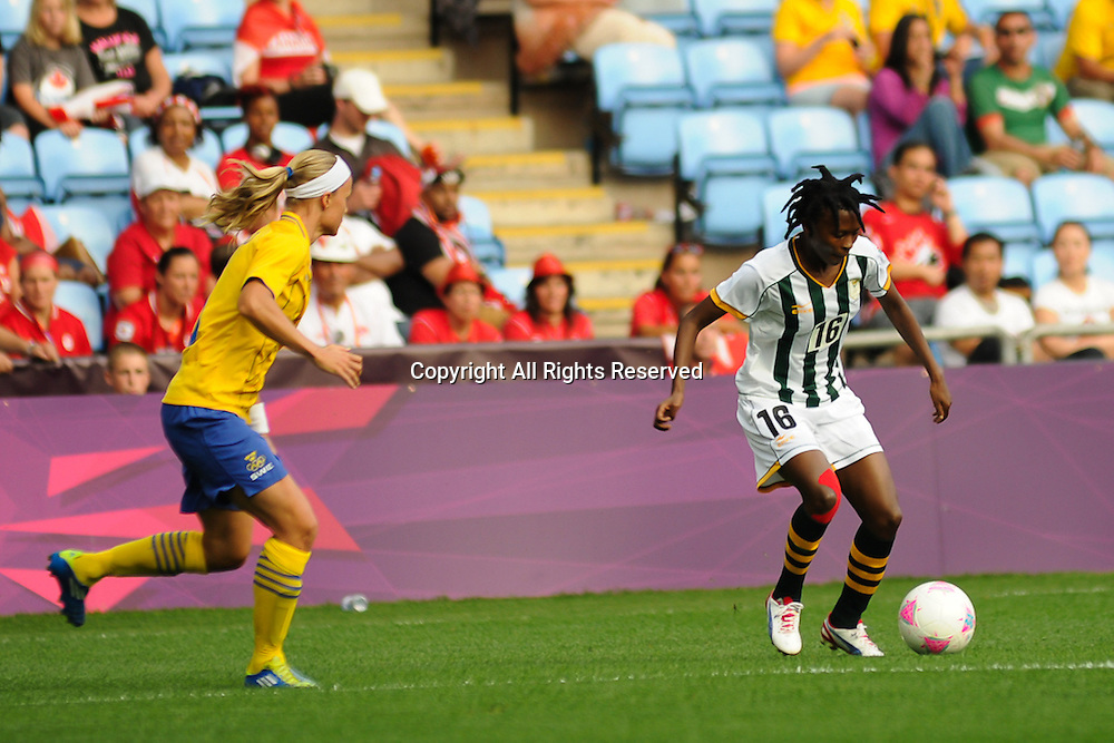25.07.2012 Coventry, England. Mpumi NYANDENI (South Africa) and Sara THUNEBRO (Sweden)  in action during the Olympic Football Women's Preliminary game between Sweden and South Africa from the City of Coventry Stadium