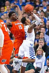 Kentucky guard Tyler Ulis, right, drives to the basket on Florida center John Egbunu in the second half.<br /> <br /> The University of Kentucky hosted the University of Florida, Saturday, Feb. 06, 2016 at Rupp Arena in Lexington .