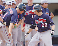 Mississippi's Alex Presley (20) is congratulated by teammate Zack Cozart (10) following a two-run home run during a college baseball game in Oxford, MIss. on Sunday, April 30, 2006. Mississippi won their tenth straight game with a 5-3 victory.   (AP Photo/Oxford Eagle, Bruce Newman)