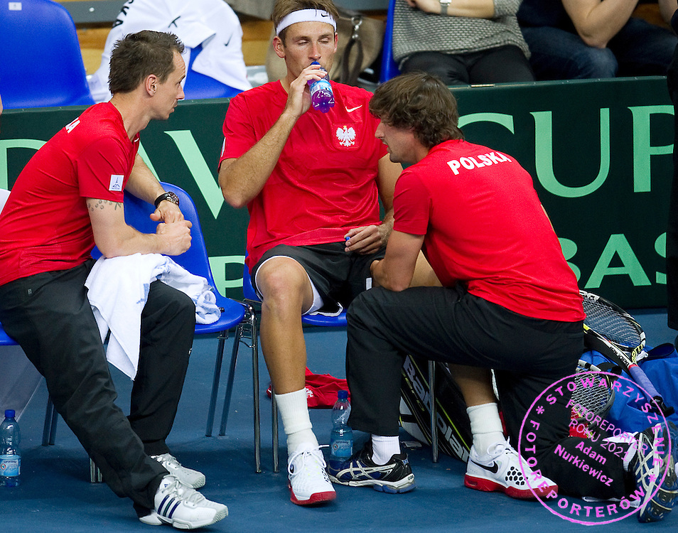 (L) Radoslaw Szymanik - captain national team & (C) Lukasz Kubot & (R) physiotherapist Krzysztof Guzowski all from Poland during first day of the BNP Paribas Davis Cup 2013 between Poland and South Africa at MOSiR Hall in Zielona Gora on April 05, 2013...Poland, Zielona Gora, April 05, 2013..Picture also available in RAW (NEF) or TIFF format on special request...For editorial use only. Any commercial or promotional use requires permission...Photo by © Adam Nurkiewicz / Mediasport