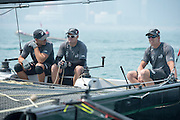 Emirates Team New Zealand, Race day one of the Land Rover Extreme Sailing Series regatta in Qingdao, China. Blair Tuke, Glenn Ashby and Peter Burling. 1/5/2014