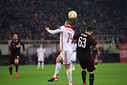 December 13, 2018 - Piraeus, Attiki, Greece - Omar Elabdellaoui (no 14) of Olympiacos and Patrick Cutrone (no 63) of Milan, vies for the ball. (Credit Image: © Dimitrios Karvountzis/Pacific Press via ZUMA Wire)