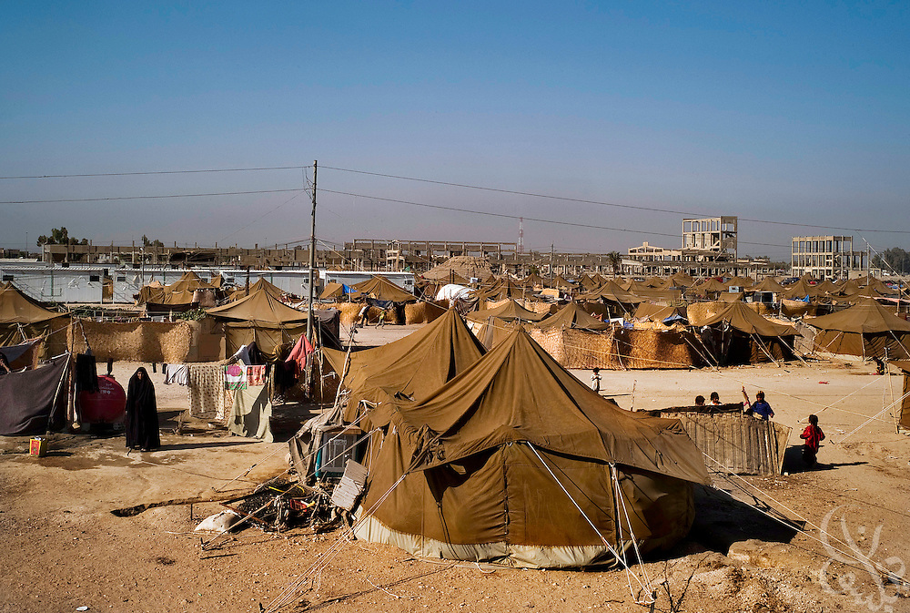 The al-Manathera IDP camp, located 20 kilometers south of the Iraqi city of An-Najaf September 21, 2007. Opened in February for 10-15 families, the camp now has swollen to 230 mostly Shia families displaced by sectarian violence in Baghdad, Falluja, and Diyala province. The families living here are dependent now on the aid of the Iraqi Red Crescent and the UNHCR. .