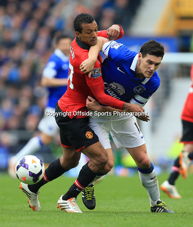 20th April 2014 - Barclays Premier League - Everton v Manchester United - Nani of Man Utd battles with Gareth Barry of Everton - Photo: Simon Stacpoole / Offside.