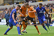 Wolverhampton Wanderers defender Barry Douglas (3) battles for possession with Cardiff City midfielder Nathaniel Mendez-Laing (19) and Cardiff City defender Sean Morrison (4) 0-0 during the EFL Sky Bet Championship match between Wolverhampton Wanderers and Cardiff City at Molineux, Wolverhampton, England on 19 August 2017. Photo by Alan Franklin.