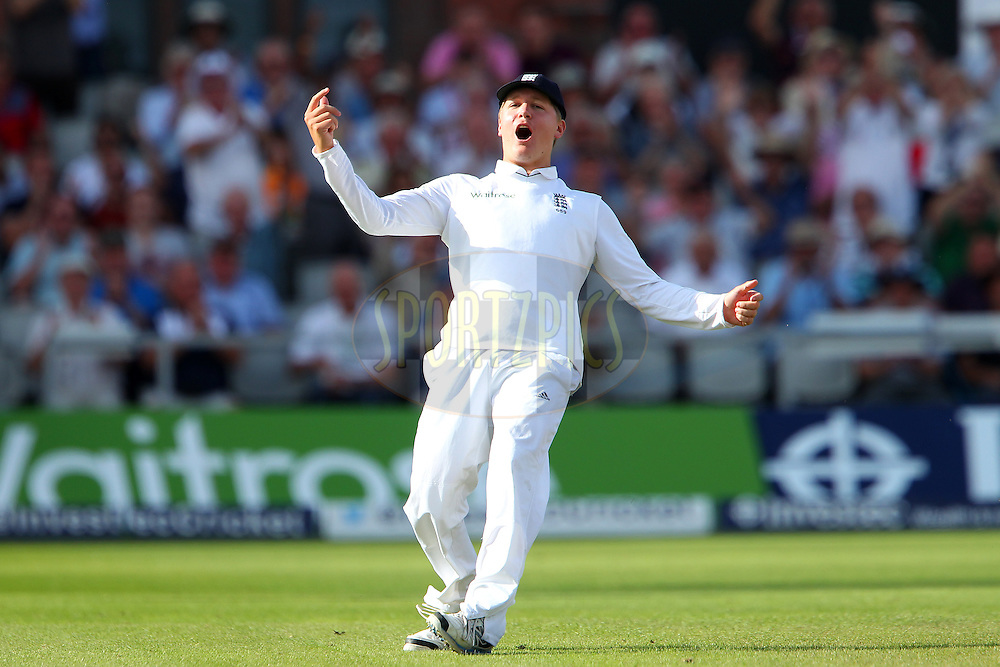 Gary Ballance of England celebrates taking the catch to dismiss Mahendra Singh Dhoni captain of India during day three of the fourth Investec Test Match between England and India held at The Emirates, Old Trafford cricket ground in Manchester, England on the 9th August 2014<br /> <br /> Photo by Ron Gaunt / SPORTZPICS/ BCCI