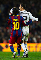 BARCELONA, SPAIN - NOVEMBER 29: Clash Ricardo Carvalho of Real Madrid and Lionel Messi of Barcelona during the La Liga match between Barcelona and Real Madrid at the Camp Nou Stadium on November 29, 2010 in Barcelona, Spain. (Photo by Manuel Queimadelos/DPPI)