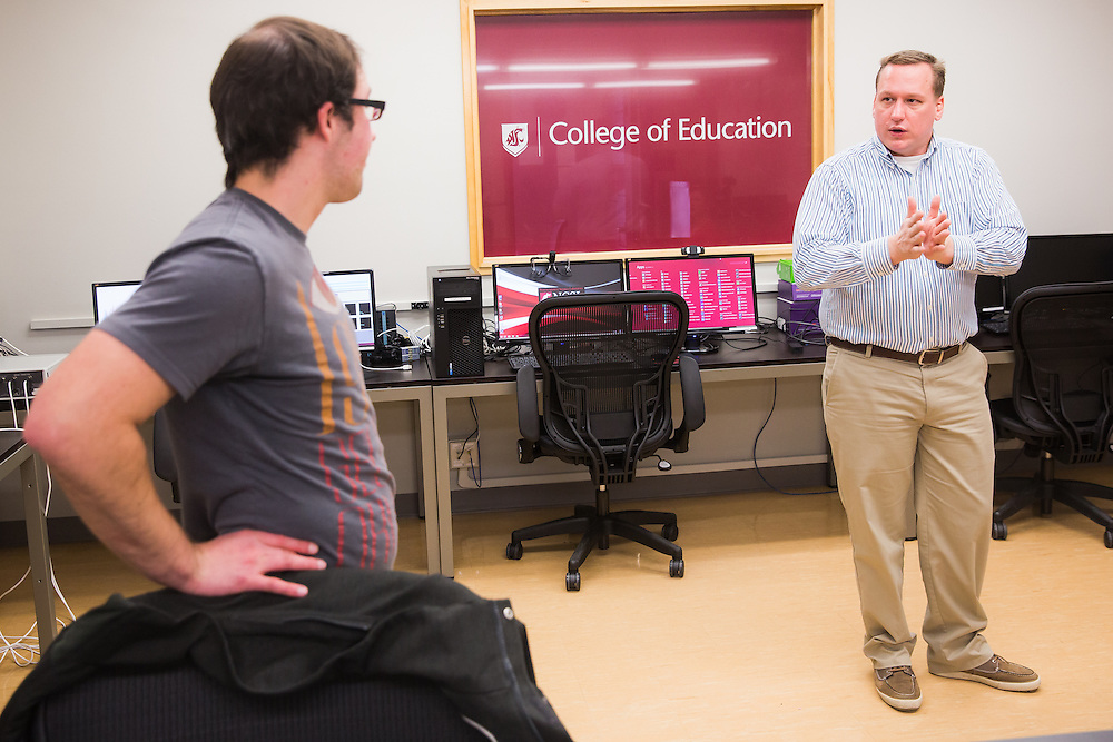 Dr. Richard Lamb, associate professor of science education measurement at Washington State University, discusses research projects with one of the researchers he works alongside in the neurcognition science lab.