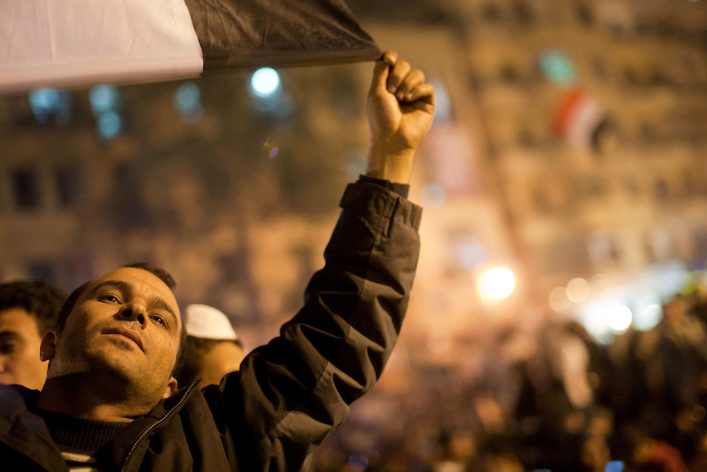 An egyptian man waves a flag at Tahrir Square on November 22, 2011 photo by: Maya Levin