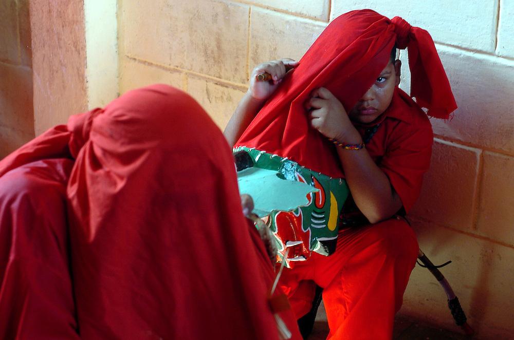 La festividad del Corpus Christi es una celebración conocida en Venezuela a través del ritual mágico-religioso de los Diablos Danzantes de Yare, que se celebra desde el siglo XVIII en San Francisco de Yare, en el estado Miranda. Cada Jueves Santo se hace una danza ritual de los llamados diablos, los cuales visten trajes coloridos (completamente de rojo), capas y máscaras de apariencia grotesca, además de adornos como cruces, escapularios, rosarios y otros amuletos, 15-06-2006. (ivan gonzalez)