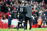 Liverpool goalkeeper Adrian (13) gets the Liverpool Manager Jurgen Klopp arm round the shoulder at the end of the Premier League match between Liverpool and Brighton and Hove Albion at Anfield, Liverpool, England on 30 November 2019.