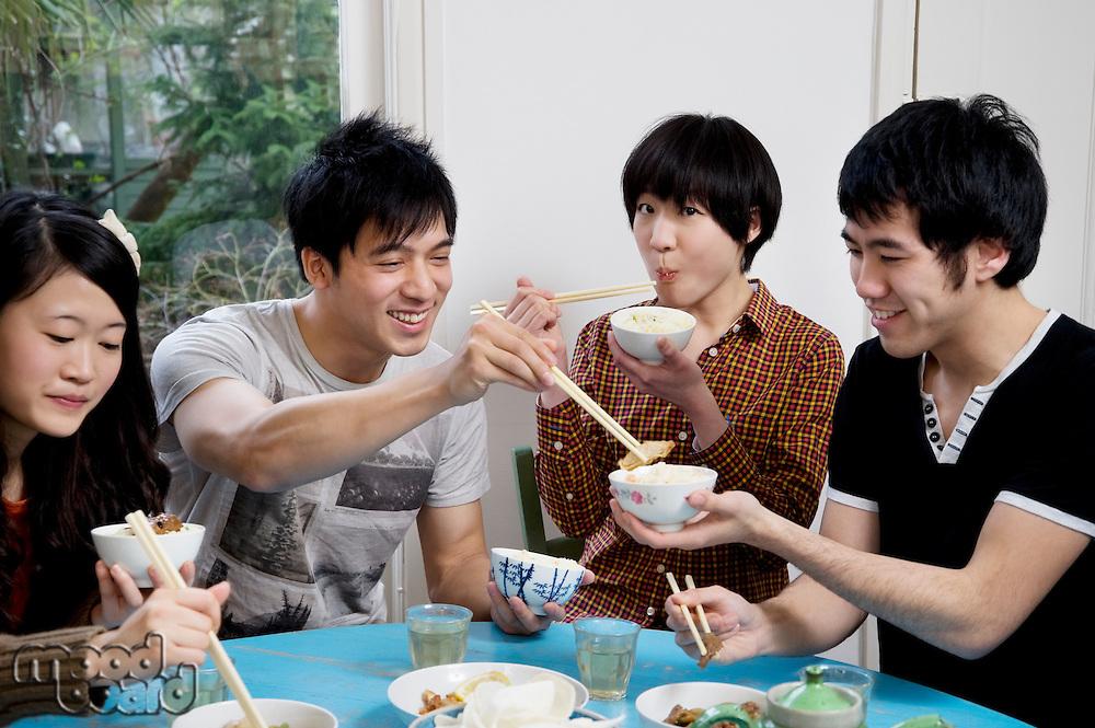 Friends enjoying breakfast together
