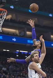 February 3, 2018 - Sacramento, CA, USA - The Sacramento Kings' Willie Cauley-Stein (00) goes to basket against the Dallas Mavericks' Dirk Nowitzki (41) at the Golden 1 Center in Sacramento Calif., on Saturday, Feb. 3, 2018. (Credit Image: © Hector Amezcua/TNS via ZUMA Wire)