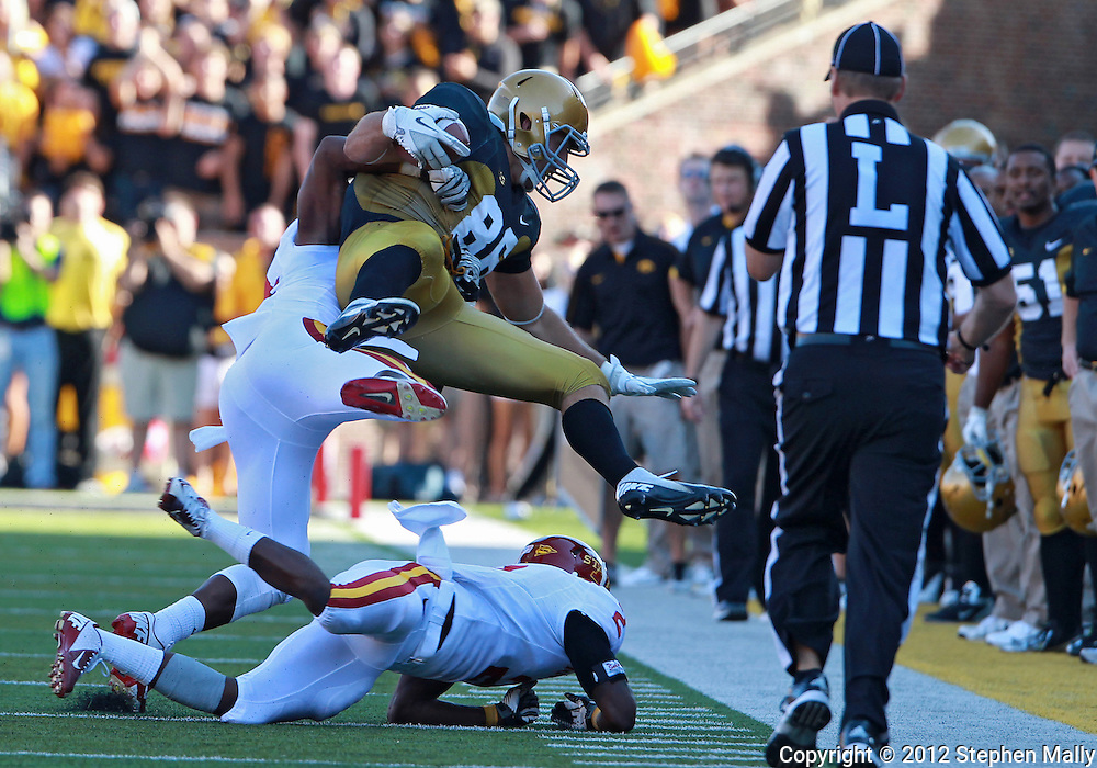 September 08 2012: Iowa Hawkeyes tight end C.J. Fiedorowicz (86) is hit by Iowa State Cyclones defensive back Durrell Givens (24) as he tries to jump over Iowa State Cyclones defensive back Jansen Watson (2) during the third quarter of the NCAA football game between the Iowa State Cyclones and the Iowa Hawkeyes at Kinnick Stadium in Iowa City, Iowa on Saturday September 8, 2012. Iowa State defeated Iowa 9-6.