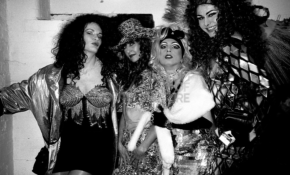 drag queens and a friend hang out before a fashion show at flesh in the hacienda manchester