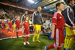 BRUSSELS, BELGIUM - Sunday, November 16, 2014: Wales' David Cotterill walks out to face Belgium during the UEFA Euro 2016 Qualifying Group B game at the King Baudouin [Heysel] Stadium. (Pic by David Rawcliffe/Propaganda)