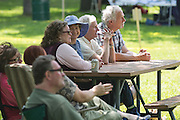 Visitors including RIT President Bill Destler and his wife Rebecca Johnson enjoy live music from the Golden Link Folk Singing Society at the Adirondack Mountain Club's Outdoor Expo at Mendon Ponds Park on Saturday, June 11, 2016.