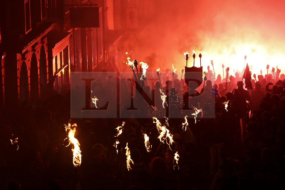 © Licensed to London News Pictures. 04/11/2017. Lewes, UK. Members of the parade carry burning torches as they take part in celebrations for the traditional Lewes Bonfire Night celebrations on Saturday, 4 November, 2017. Thousands of people attend the parade through the narrow streets of Lewes and burn effigies to celebrate Guy Fawkes nightalso known as bonfire night, the anniversary of the gunpowder plot to blow up the Houses of Parliament in London. Photo credit: London News pictures