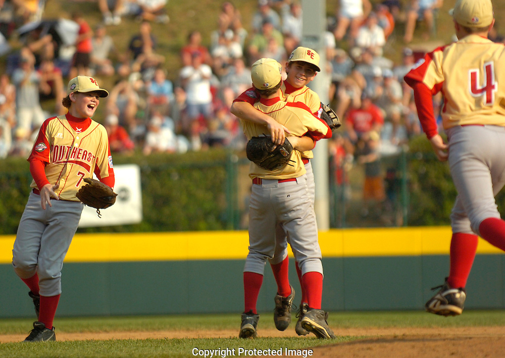 Jodi Miller.Southeast pitcher Dalton Carriker (2) hugs short stop Zane Conlon (5) after Conlon caught a hit for an out by Bryndan Arredondo to end the inning with bases loaded.