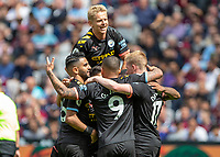 Football - 2019 / 2020 Premier League - West Ham United vs. Manchester City<br /> <br /> Oleksandr Zinchenko (Manchester City) laps on his team mates as they celebrate scoring at the London Stadium<br /> <br /> COLORSPORT/DANIEL BEARHAM