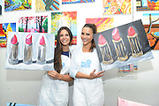 Reality TV dating star Andi Dorfman, right, and her friend Ashley Cook, accessories designer, embrace girl time with a housewarming event at the Painting Lounge hosted by Palm Breeze, a new tropical sparkling alcohol spritz from Mike's Hard Lemonade Co., Thursday, Aug. 6, 2015 in New York. (Diane Bondareff/AP Images for Palm Breeze)