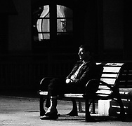 A man sits on a bench on March 18, 2013, in the Northern Spanish Basque village of Gernika.