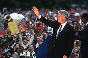 President Bill Clinton waves to supporters during a campaign stop for his re-election August 27, 1996 in Pontiac, MI