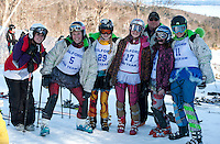 The Gilford girls alpine ski team Kelly Gallant, Meagan Pleeter, Emily Watson,  Caitlin Houston, Coach Peter Colbath, Emily Hanf and Grace McLaughlin brought out their tutu's for some fun during the high school alpine ski meet at Gunstock Friday morning.  (Karen Bobotas/for the Laconia Daily Sun)