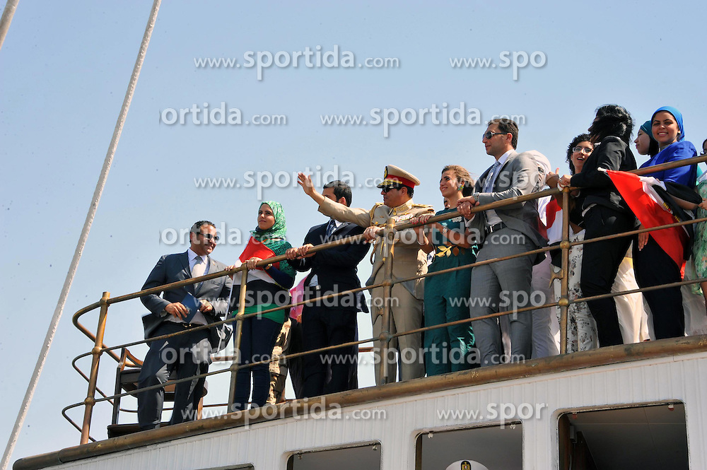 06.08.2015, Sueskanal, EGY, Sueskanal Kanal Erweiterung, im Bild Feierlichkieiten zur Sueskanal Erweiterung // Egyptian President Abdel-Fattah el-Sissi waves from a monarchy-era yacht that sailed to the venue of a ceremony unveiling a major extension of the Suez Canal in Ismailia, August 6, 2015. El-Sissi has billed the extension as an historic achievement needed to boost the country s ailing economy after years of unrest, Egypt on 2015/08/06. EXPA Pictures &copy; 2015, PhotoCredit: EXPA/ APAimages/ Egyptian President Office<br /> <br /> *****ATTENTION - for AUT, GER, SUI, ITA, POL, CRO, SRB only*****