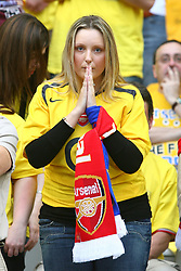 PARIS, FRANCE - WEDNESDAY, MAY 17th, 2006: An Arsenal fan prays duringe the UEFA Champions League Final against FC Barcelona at the Stade de France. (Pic by David Rawcliffe/Propaganda)