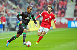 30.03.2013, Coface Arena, Mainz, GER, 1. FBL, 1. FSV Mainz 05 vs SV Werder Bremen, 27. Runde, im Bild Theodor Gebre Selassie (Bremen #23) am Ball, verfolgt von Andreas Ivanschitz (1. FSV Mainz 05 #25) // during the German Bundesliga 27th round match between 1. FSV Mainz 05 and SV Werder Bremen at the Coface Arena, Mainz, Germany on 2013/03/30. EXPA Pictures © 2013, PhotoCredit: EXPA/ Andreas Gumz ***** ATTENTION - OUT OF GER *****