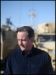 The Prime Minister David Cameron during TV News interviews at Camp Bastion on a visit to Afghanistan. Monday, 16th December 2013. Picture by Andrew Parsons / i-Images