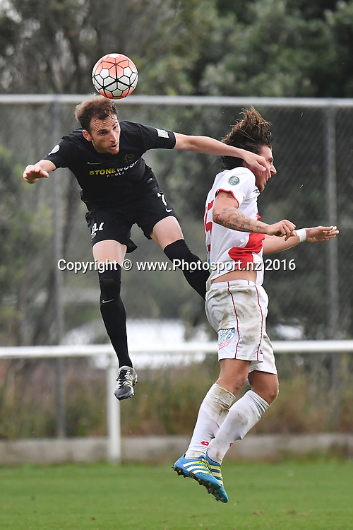 Team Wellington's Leonardo Villa (L) jumps for the ball with Waitakere's Pascal Reinhardt during the Premiership semi-final football match between Wellington & Waitakere at David Farrington Park in Miramar on Sunday the 26th March 2017. Copyright Photo by Marty Melville / www.Photosport.nz