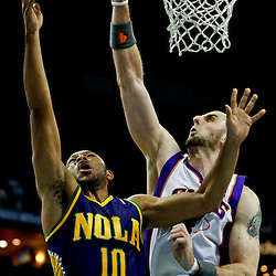 Feb 6, 2013; New Orleans, LA, USA; New Orleans Hornets shooting guard Eric Gordon (10) shoots over Phoenix Suns center Marcin Gortat (4) during  the first quarter of a game at the New Orleans Arena. Mandatory Credit: Derick E. Hingle-USA TODAY Sports