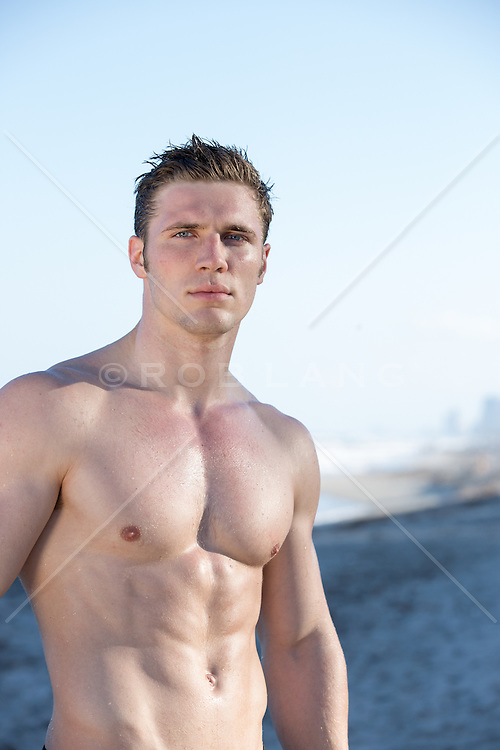 All American good looking shirtless man at the beach