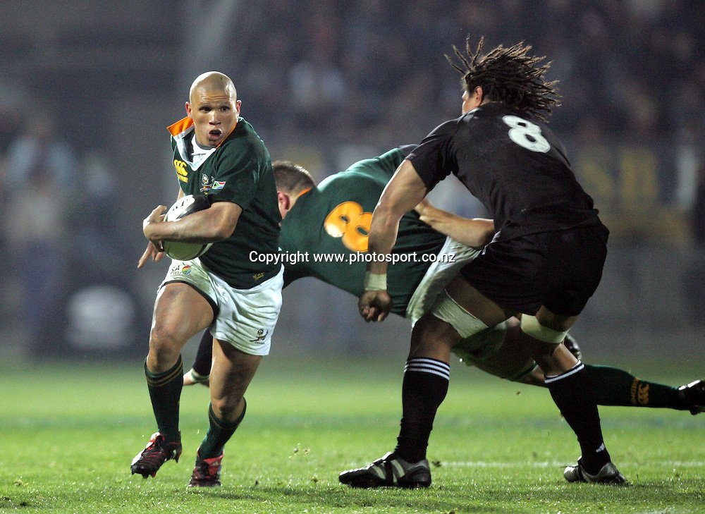 South African halfback Enrico Januarie in action during the Tri Nations rugby test match between the All Blacks and South Africa at Carisbrook in Dunedin, New Zealand on Saturday 27 August, 2005. The All Blacks won 31-27. Photo: Hannah Johnston/PHOTOSPORT<br /><br /><br />132851