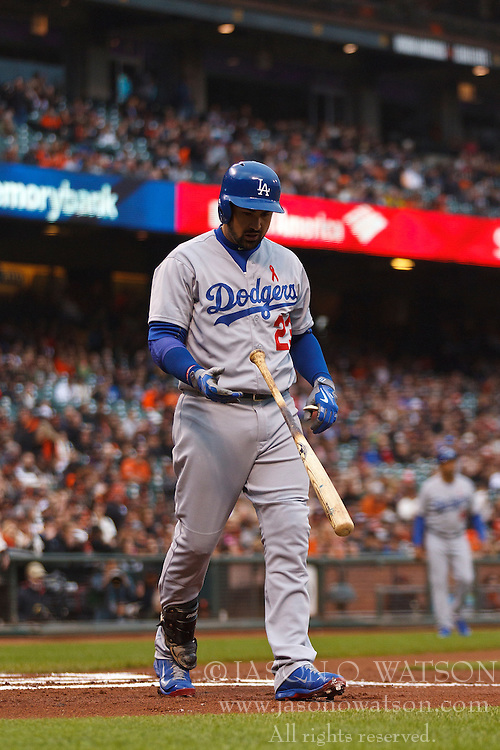 SAN FRANCISCO, CA - MAY 20:  Adrian Gonzalez #23 of the Los Angeles Dodgers returns to the dugout after striking out against the San Francisco Giants during the first inning at AT&T Park on May 20, 2015 in San Francisco, California.  The San Francisco Giants defeated the Los Angeles Dodgers 4-0. (Photo by Jason O. Watson/Getty Images) *** Local Caption *** Adrian Gonzalez