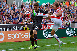 STOKE-ON-TRENT, ENGLAND - Sunday, August 9, 2015: Liverpool's Roberto Firmino in action against Stoke City during the Premier League match at the Britannia Stadium. (Pic by David Rawcliffe/Propaganda)