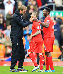 Liverpool Manager, Jurgen Klopp celebrates with goalscorer Alberto Moreno - Mandatory by-line: Matt McNulty/JMP - 10/04/2016 - FOOTBALL - Anfield - Liverpool, England - Liverpool v Stoke City - Barclays Premier League