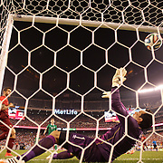 Vierinha, (left), Portugal, scores his sides fourth goal beating Ireland goalkeeper David Forde from close range  during the Portugal V Ireland International Friendly match in preparation for the 2014 FIFA World Cup in Brazil. MetLife Stadium, Rutherford, New Jersey, USA. 10th June 2014. Photo Tim Clayton