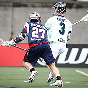 Matt Abbott #3 of the Chesapeake Bayhawks keeps the ball away from Kevin Buchanan #27 of the Boston Cannons during the game at Harvard Stadium on April 27, 2014 in Boston, Massachusetts. (Photo by Elan Kawesch)