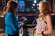 13 MAY 2011 - PHOENIX, AZ: KPNX anchoe Syleste Rodriguez, left, talks to Kylee during a break in her concert Friday nigh. Kylee Saunders is a teen pop sensation in Japan, but a normal high school student in Chandler, where she lives. The teenager has a recording deal with Sony and commutes from Arizona to Japan to promote her records.      PHOTO BY JACK KURTZ