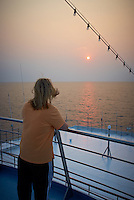 Jenny Shooting Sunrise on the M/V Explorer. Image taken with a Leica X1 (ISO 100, 24 mm, f/5, 1/250 sec) Raw image processed with Capture One Pro 6, Focus Magic, and converted to JPG/sRGB with Photoshop CS5.