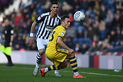 West Bromwich Albion defender Kieran Gibbs (3) battles for possession  with Swansea City defender Connor Roberts (23) during the EFL Sky Bet Championship match between West Bromwich Albion and Swansea City at The Hawthorns, West Bromwich, England on 8 December 2019.