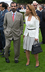 Sheikh Mohammed bin Rashid Al Maktoum. and his wife<br /> Princess Haya bint Al Hussein on the second day of Glorious Goodwood<br /> London, United Kingdom,<br /> Wednesday, 31st July 2013<br /> Picture by i-Images